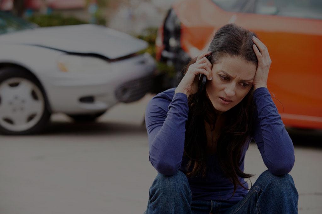 female at car accident scene